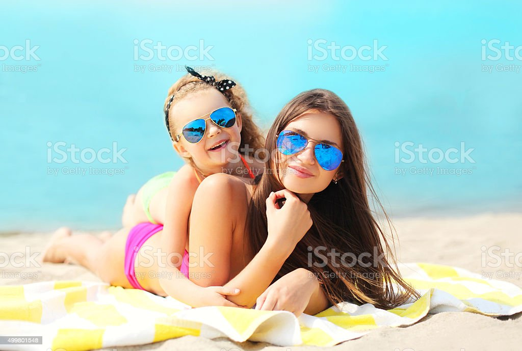 Summer vacation, relaxation, travel - mother and child lying res stock photo