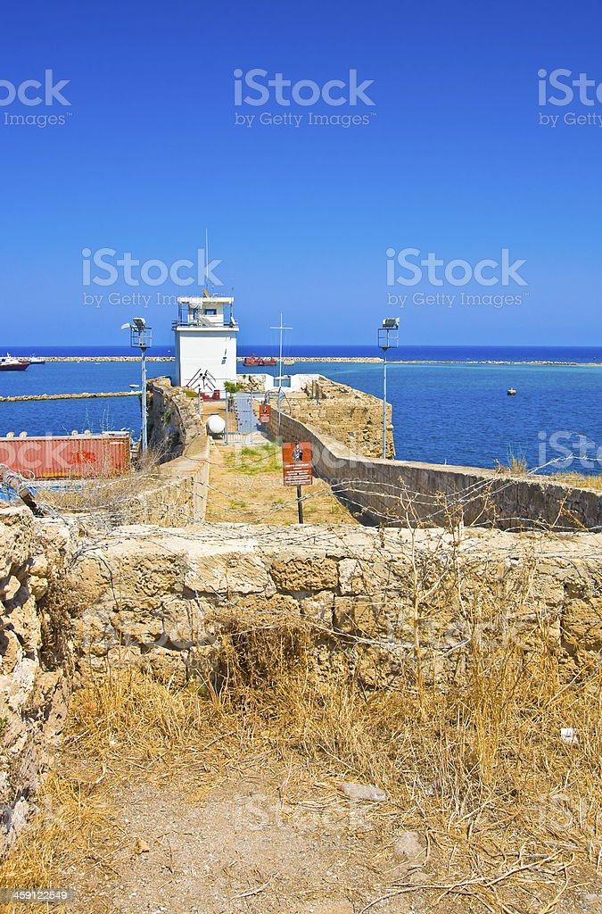 Summer view of sea through barbed wire . Famagusta. Northern Cyprus royalty-free stock photo