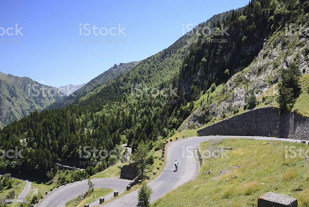 Summer view with a mountain road in Pyrenees stock photo