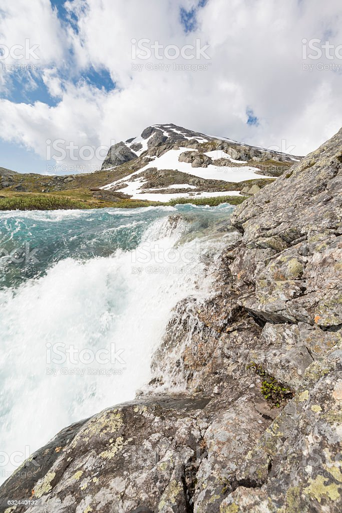 Summer warmth melts snow and ice in Norwegian mountains stock photo