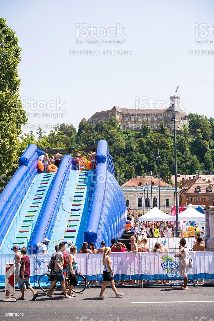 Summer water slide on  Congress Square in Ljubljana, Slovenia stock photo