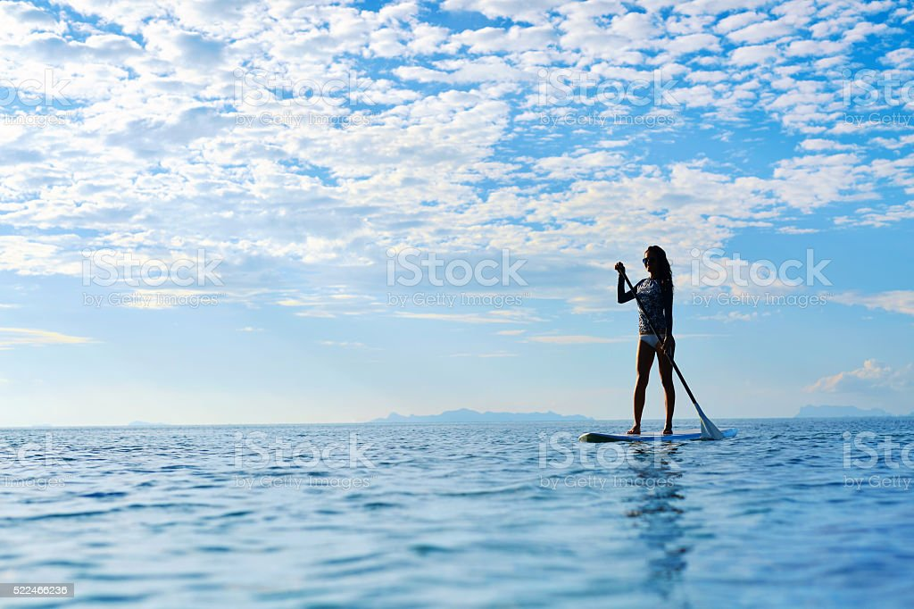 Summer Water Sports. Woman Silhouette In Sea. Healthy Lifestyle. stock photo