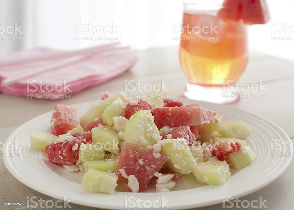 Summer watermelon and cucumbers salad stock photo