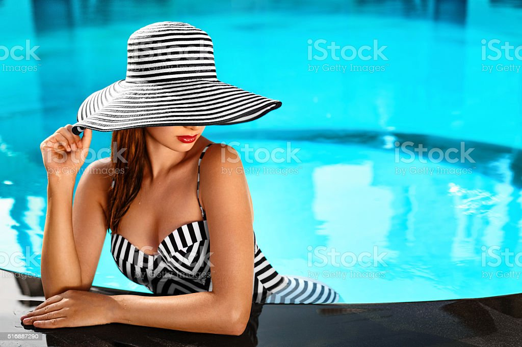 Summer Woman Body Care. Relaxation In Swimming Pool. Holidays Vacation stock photo