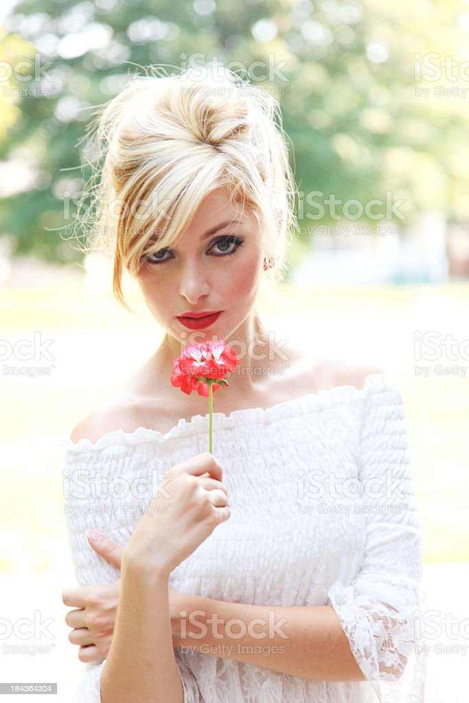 Summer woman holding a flower royalty-free stock photo