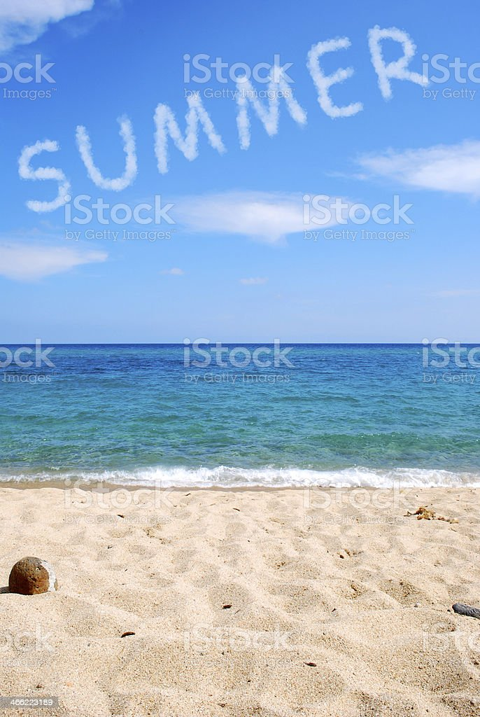 Summer word written with cloud at the beach stock photo