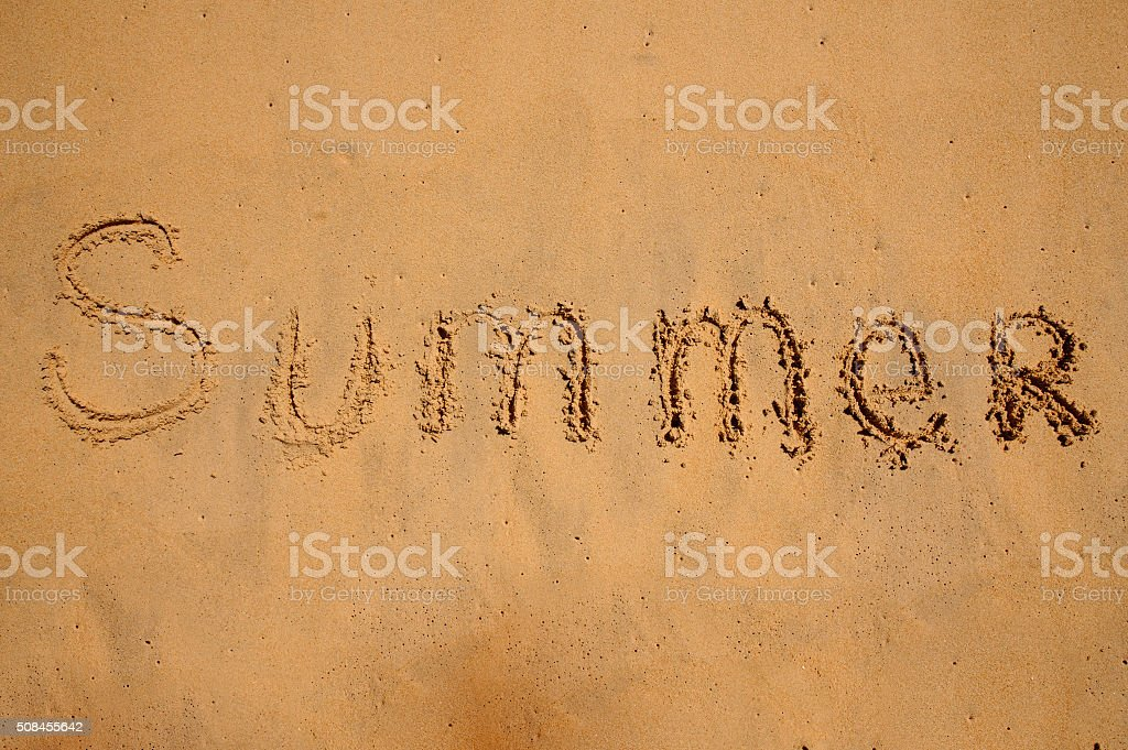 Summer, written in the sand stock photo