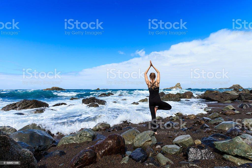 Summer yoga session be ocean stock photo