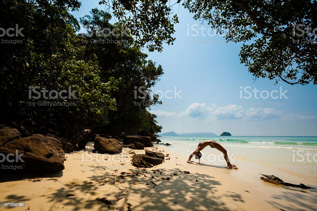 Summer yoga session in beautiful tropical island stock photo