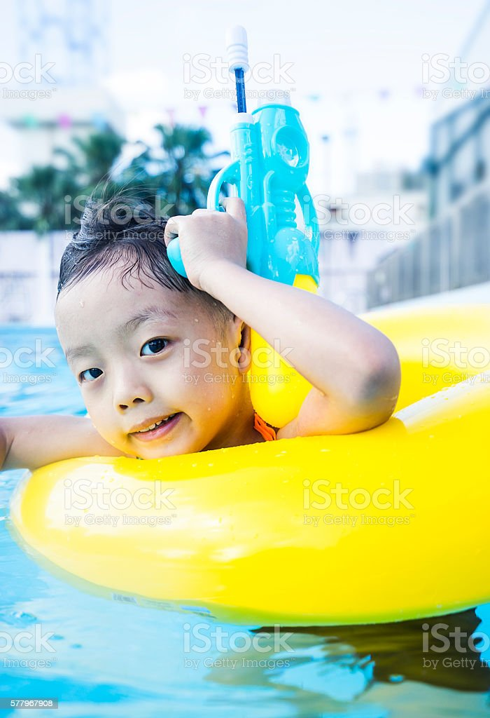 Summertime and swimming activities for happy children on the pool stock photo