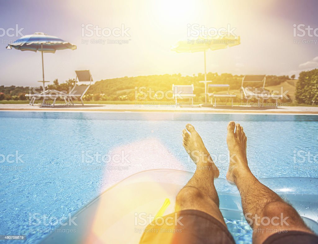 Summertime at the swimming pool stock photo