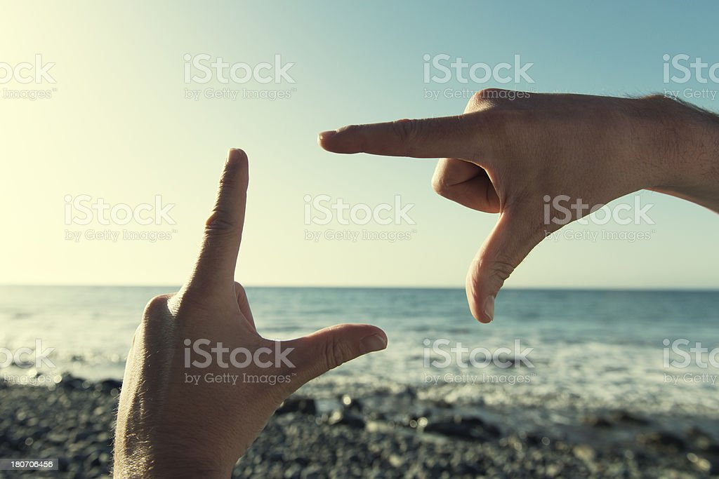 Summertime finger frame on a beach royalty-free stock photo