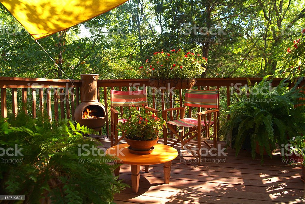 Summertime on a Lavish Deck in the Woods royalty-free stock photo