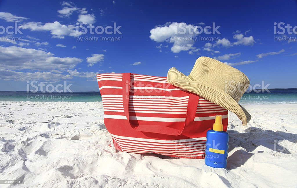 Summertime sun protection sunscreen hat at the beach stock photo