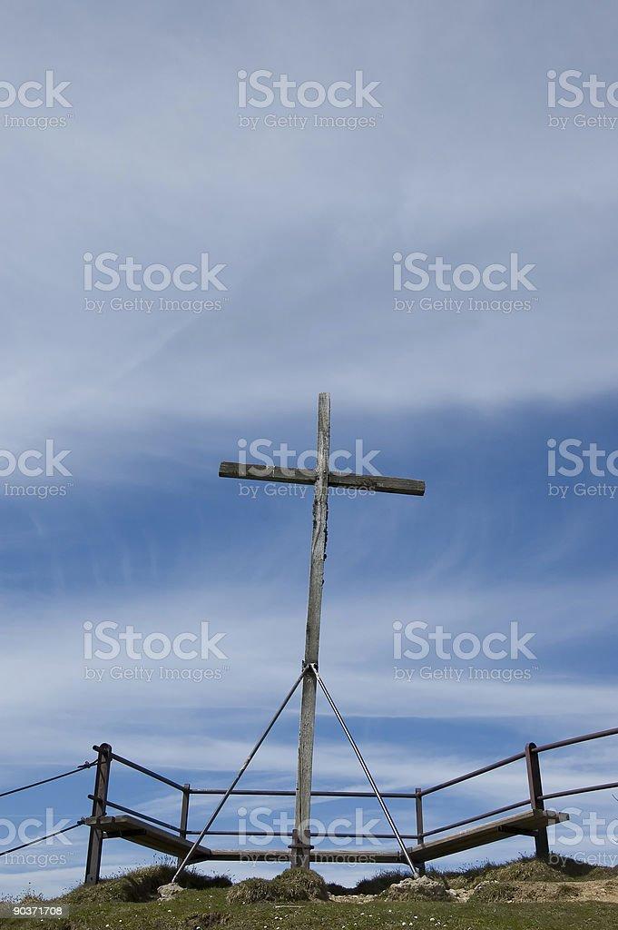 Summit cross in the alps stock photo