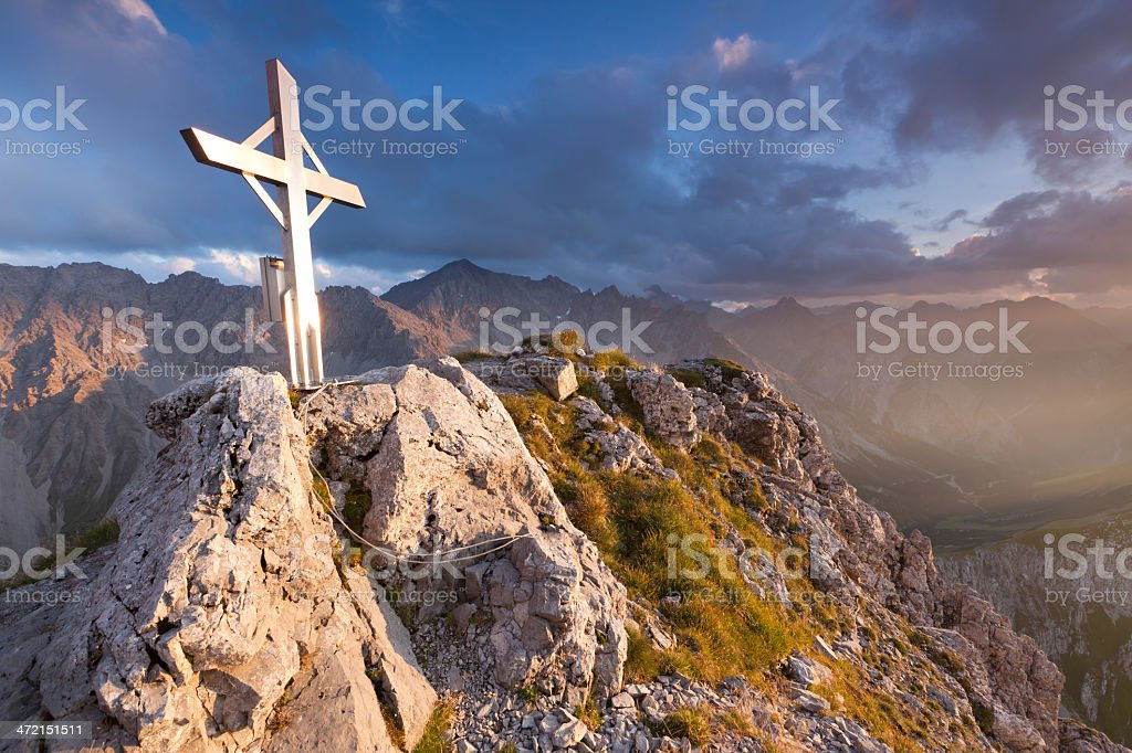 summit cross on mt. falschkogel, dramatic sunset, lechtaler alps stock photo