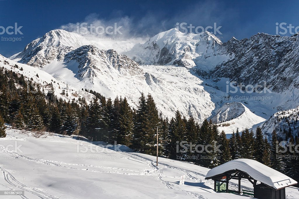 Summit in Alps with strong winds stock photo