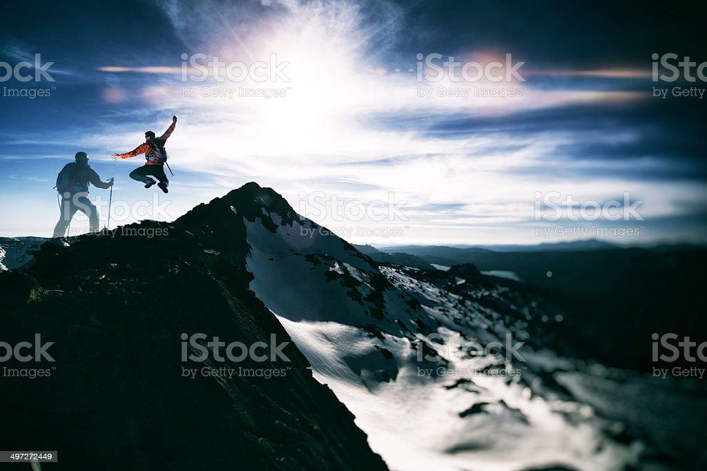 summit jump stock photo