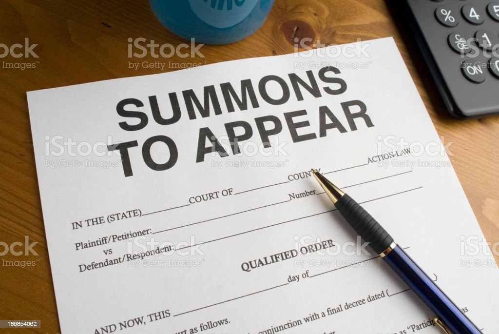 Summons to appear in court royalty-free stock photo