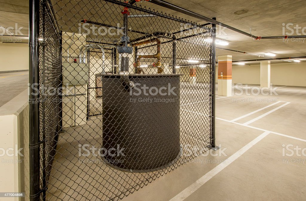 Sump Tank and Pumps in Basement of a Parking Garage stock photo