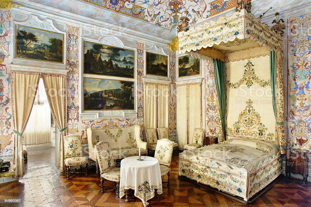 Sumptuous coloured bed-room in baroque style, Guarene Castle royalty-free stock photo