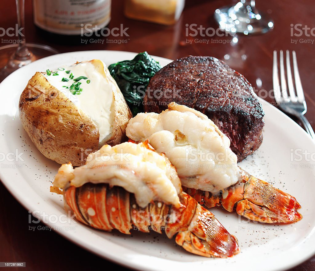 A sumptuous meal of surf and turf with lobster stock photo