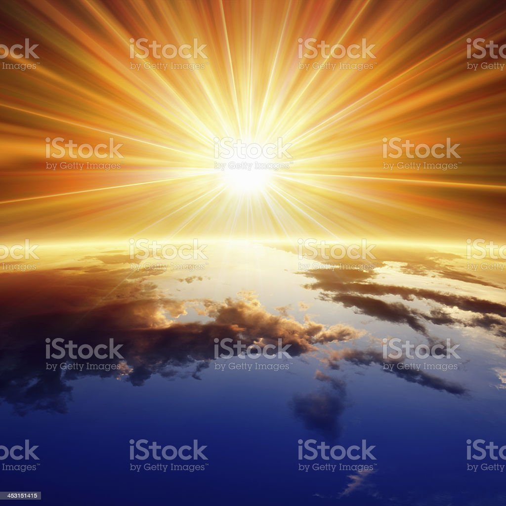 Sun above Earth stock photo