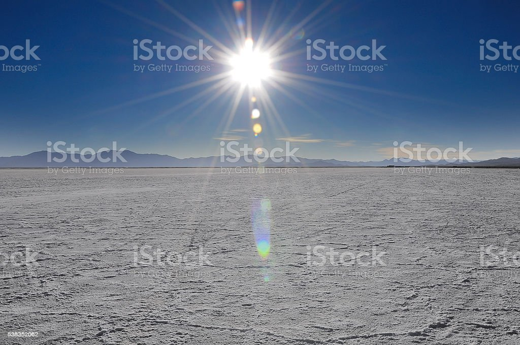 Sun above salt desert in Jujuy province. stock photo