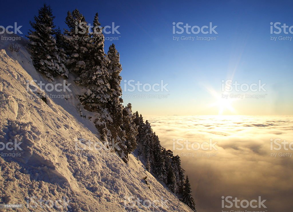 Sun above the sea of clouds stock photo