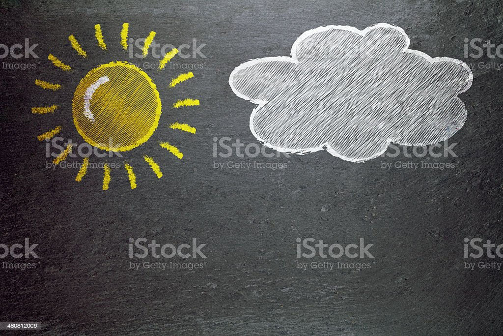 sun and a cloud drawn on a blackboard stock photo