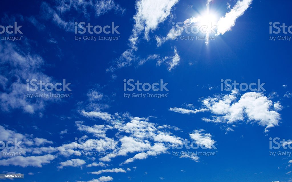 sun and clouds on blue sky royalty-free stock photo