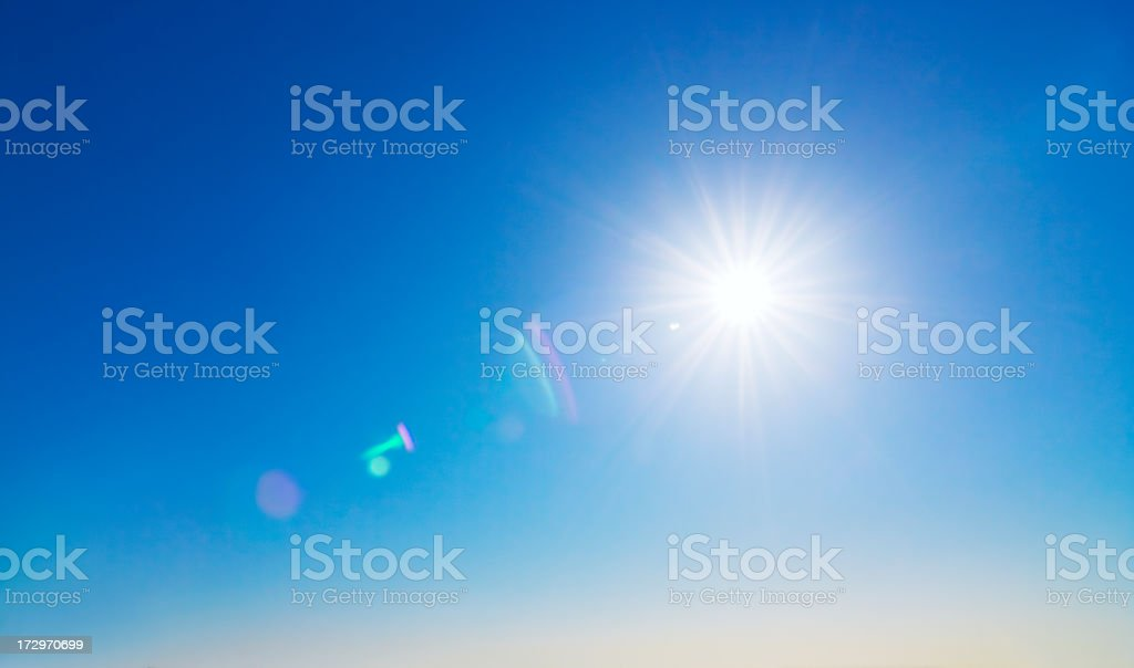 Sun and lens flare background stock photo