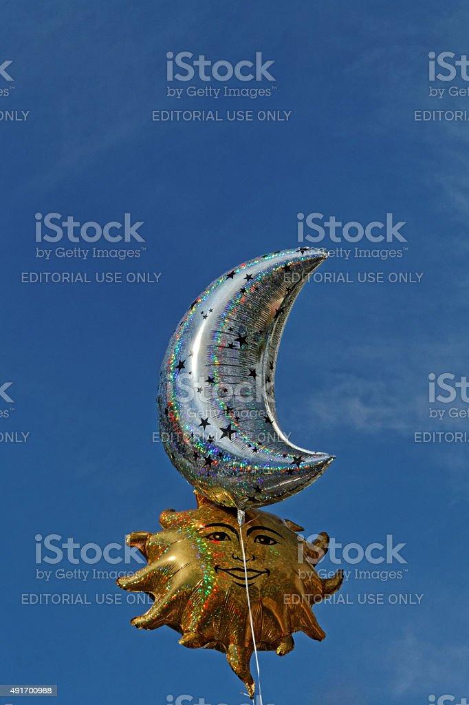 sun and moon balloon stock photo