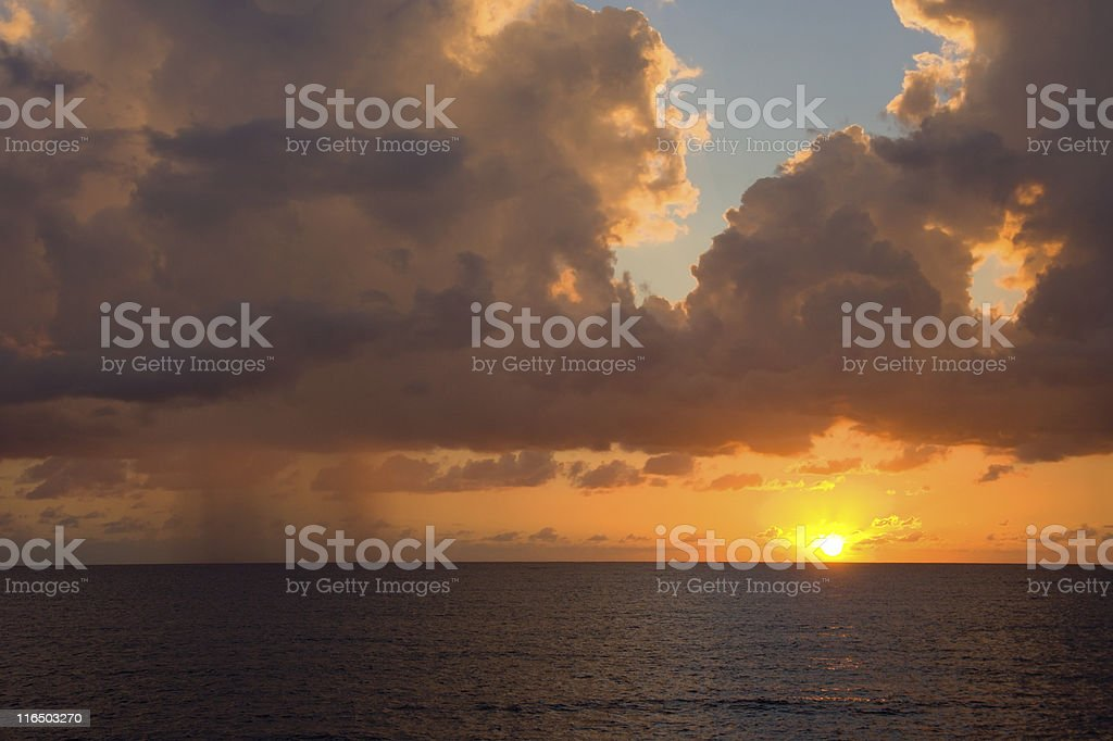 Sun And Rain Over Sea royalty-free stock photo