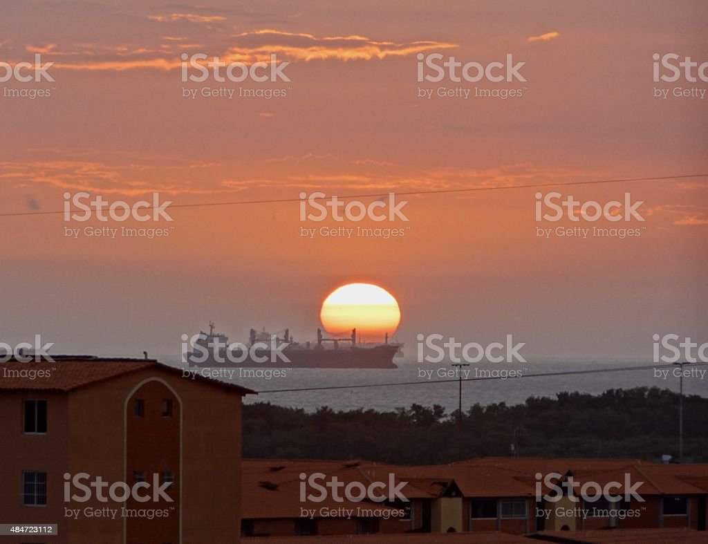 Sun and tankers next day stock photo