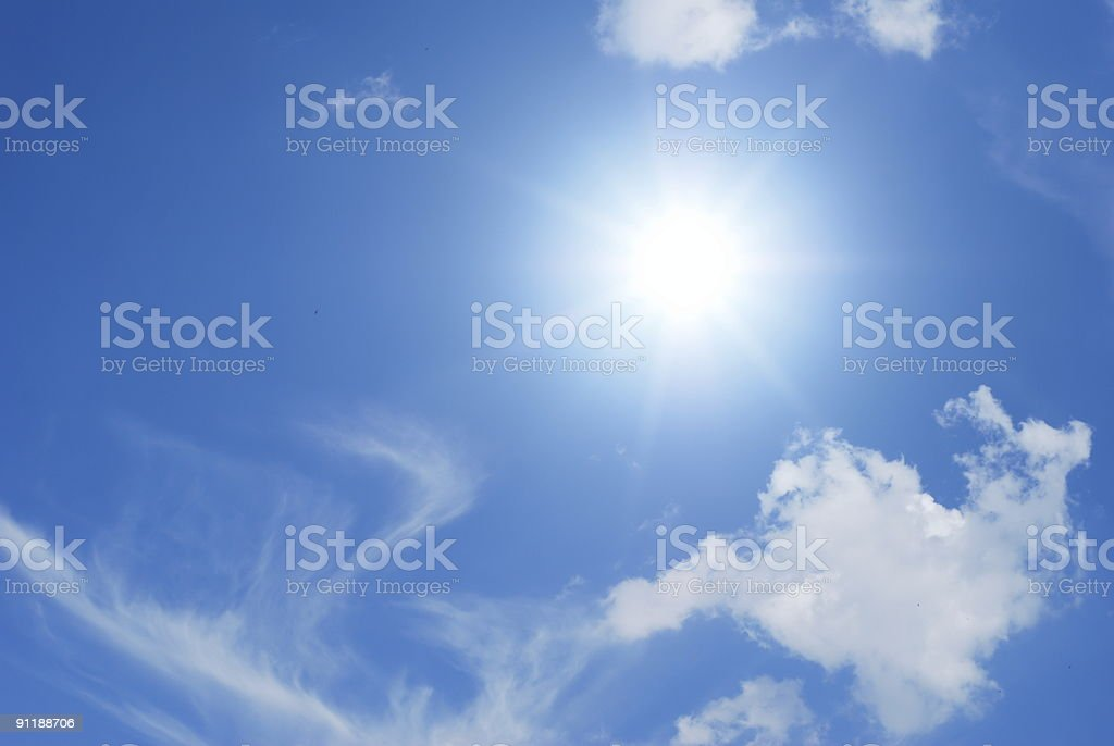 Sun and white clouds stock photo