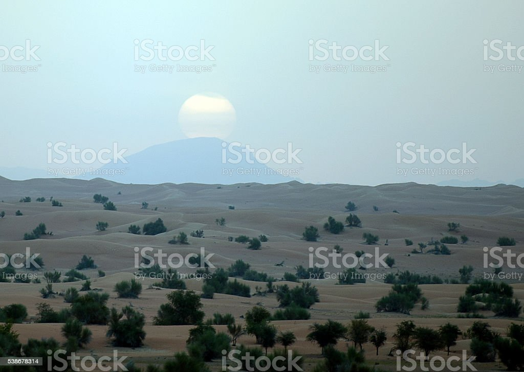 Sun at dawn - Arabian Desert, Dubai, UAE stock photo