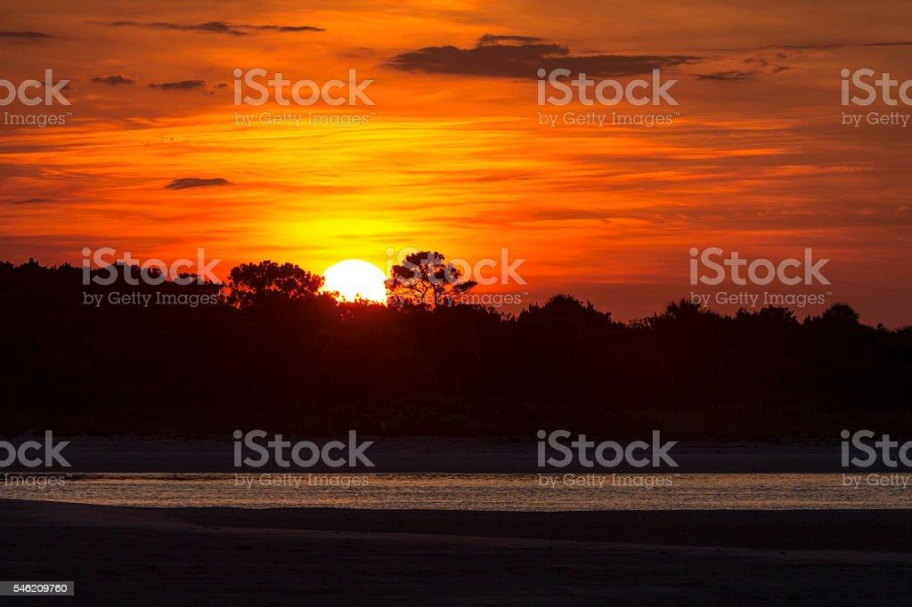 Sun at Horizon's Edge stock photo