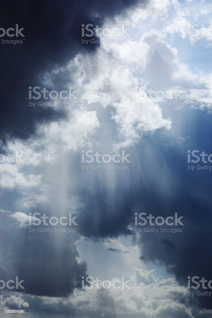 Sun beams bursting through a dramatic sky royalty-free stock photo