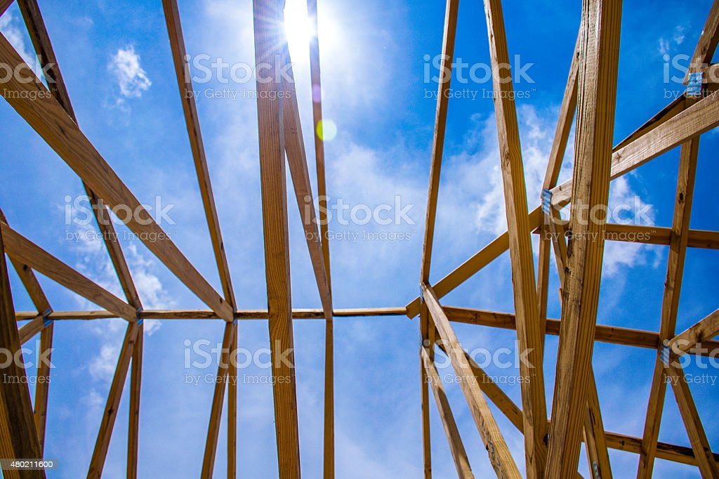 Sun Beams Empty Framed House Blue Sky 2x4 Framing stock photo