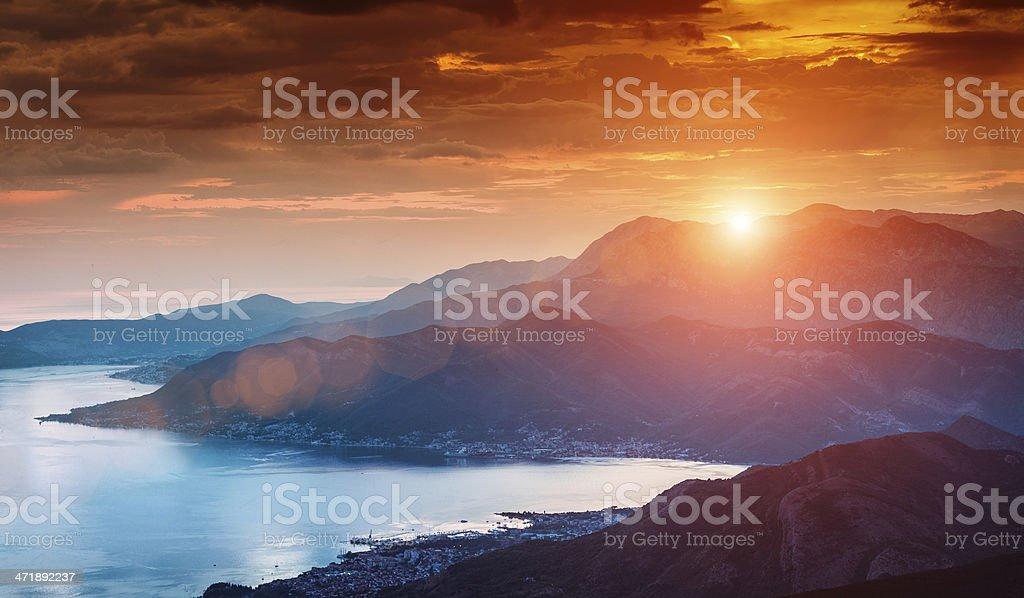 Sun beams through clouds stock photo