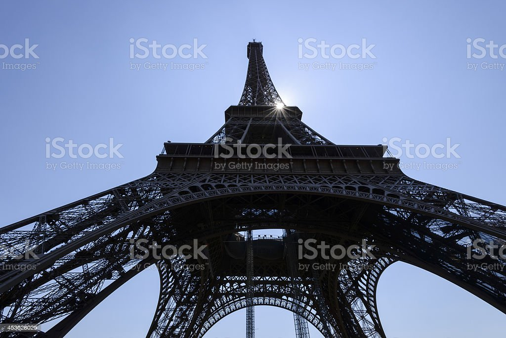 Sun beams through frame of the Eiffel Tower, Paris royalty-free stock photo