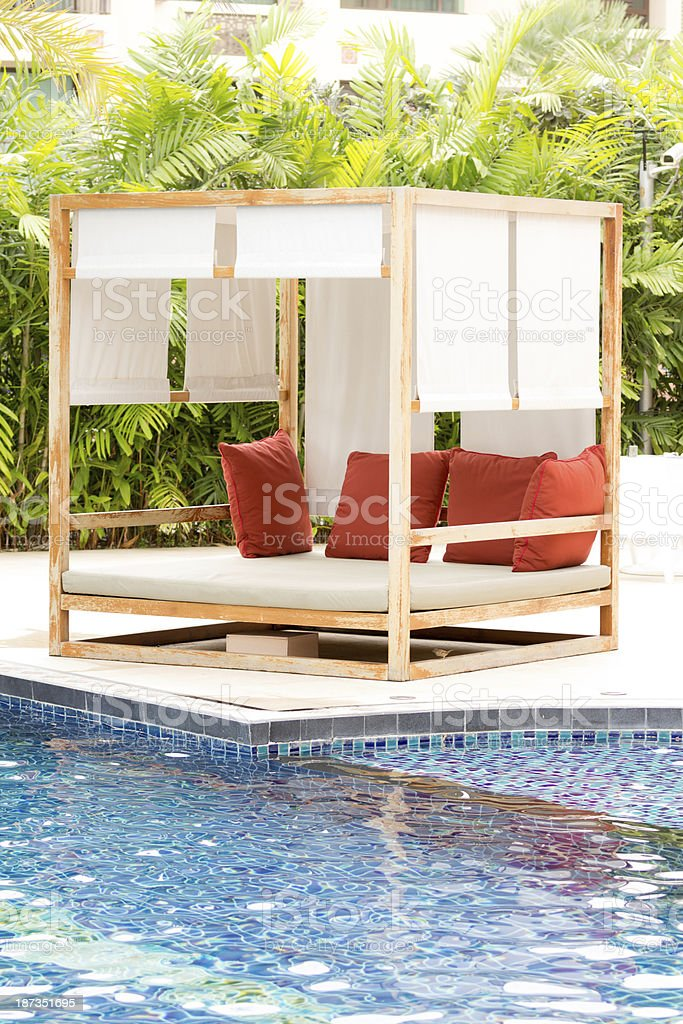 sun bed beside the pool royalty-free stock photo