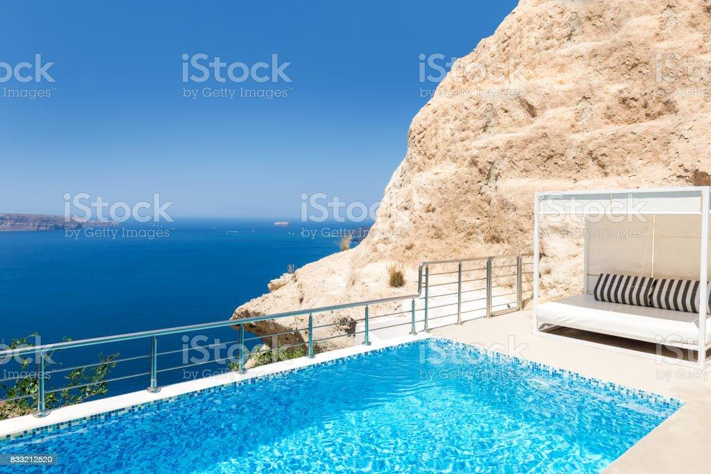 Sun bed & swimming pool & Aegean sea stock photo