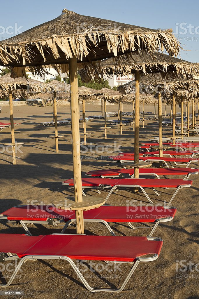 Sun beds in late afternoon royalty-free stock photo
