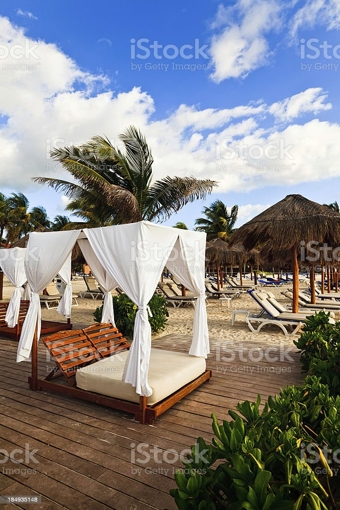 Sun Beds on Beach in Resort, Playa Del Carmen, Mexico royalty-free stock photo