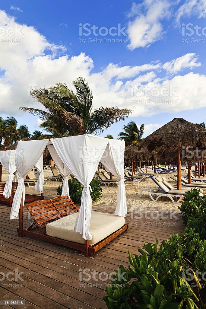 Sun Beds on Beach in Resort, Playa Del Carmen, Mexico stock photo