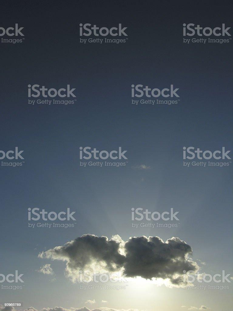 Sun Behind  Cloud on  Dark Blue Sky royalty-free stock photo