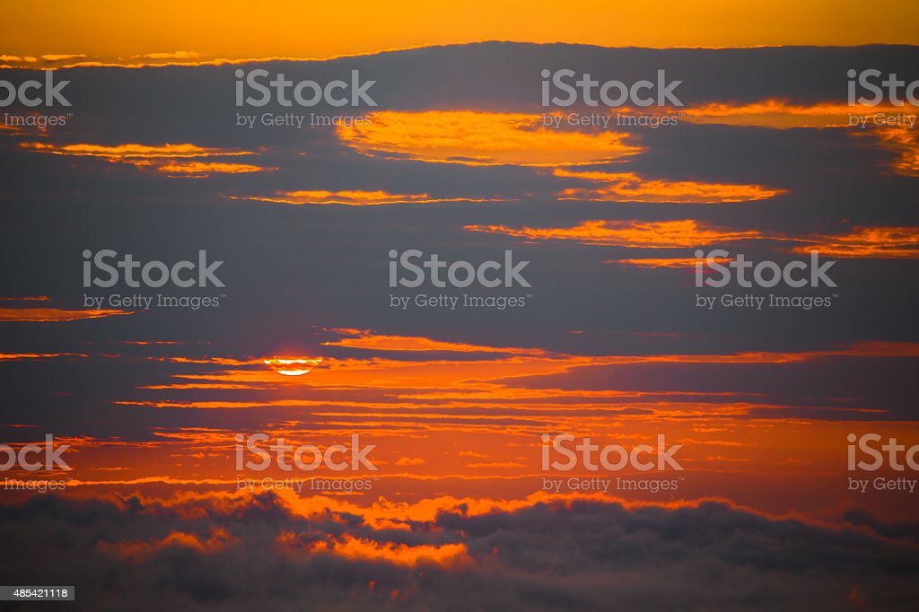 Sun Behind Clouds stock photo