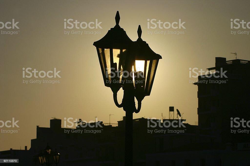 Sun behind lantern royalty-free stock photo